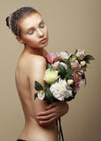 Young Dreamy Woman with Bouquet of Flowers Stock Images