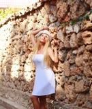 Young dreamy woman enjoy the sunlight Stock Photos