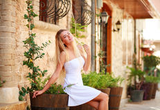 Young dreamy woman relaxing on streets old tourist town Royalty Free Stock Photography