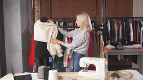 Young dressmaker creating a garment