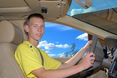 Young driver. Behind steering wheel Stock Photography