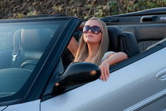 Young driver. Young girl in cabrio car, on sunset light Stock Photography
