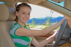 Young driver. Young teen learn how to drive a car Royalty Free Stock Image