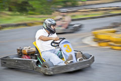 Young driver Go Kart left hand bend. Horizontal landscape of young male driver taking a left hand hairpin bend extra fast. Generic shot location Goa India Stock Photography