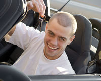 Young driver holding keys Stock Images