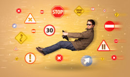 Young driver with road signs around him Stock Image