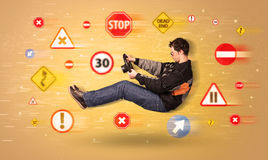 Young driver with road signs around him Stock Photo