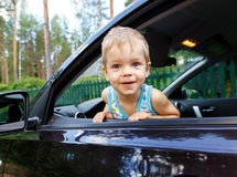 Young driver sitting inside automobile Stock Photos