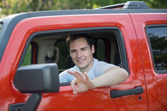 Young Driver Smiling Sitting in Driver Seat Stock Images