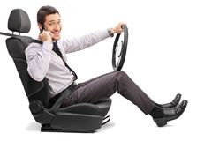 Young driver talking on cell phone Stock Photography