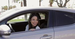 Young driver waving hand to friend stock footage