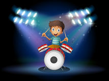 A young drummer at the center of the stage. Illustration of a young drummer at the center of the stage Royalty Free Stock Image