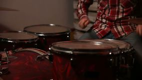 Young drummer playing at drum set stock video footage