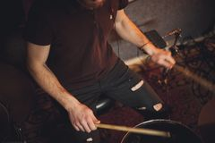 Young drummer playing at drums set Stock Image