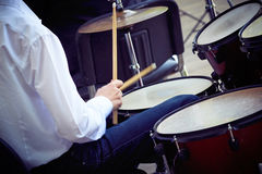 Young drummer plays the drum set. Speech at the concert stock images