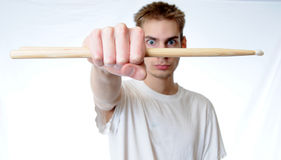 Young drummer spinning his stick Stock Images