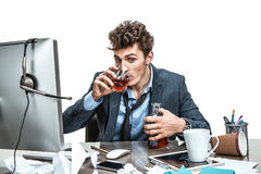 Young drunk caucasian businessman with bottle of alcohol Royalty Free Stock Photography