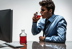 Young drunk caucasian businessman with bottle of alcohol Stock Photos