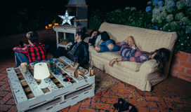 Young drunk friends sleeping in a sofa after party royalty free stock images