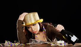 Young drunk woman  with empty champagne bottle Stock Photography