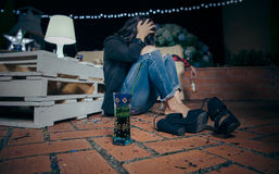 Young drunk woman sitting in the floor after party stock image