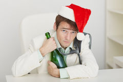 Young drunkard celebrates new year at office Stock Photography