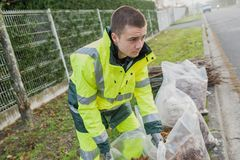 Young dustman cleans streets Stock Photography