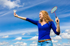 Young dutch woman holding shuttle and badminton racket Stock Photos