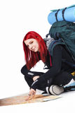 Young Dyed Hair Female Tourist Pointing On Map Stock Images