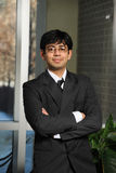 Young Eastern Businessman. With arms crossed inside an office building Royalty Free Stock Images