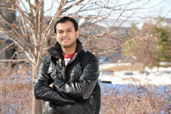 Young Eastern College Student. Posing with Campus on the background Royalty Free Stock Image