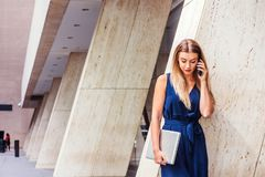 Young Eastern European American Woman talking on cell phone outs Royalty Free Stock Photos