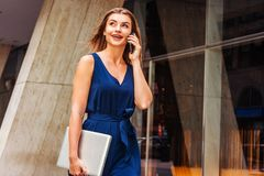 Young Eastern European American Woman talking on phone, traveling, working in New York stock photos