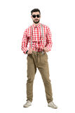 Young eccentric hipster stretching suspenders looking at camera Stock Photos