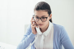 Young secretary at work stock photography