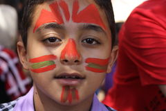 Young Egyptian boy. A portrait of a happy young boy had his face painted in Giza, Egypt Stock Photography