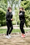 Two woman exercising in the park stock images