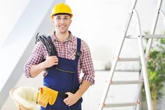 Young electrician standing stepladder Stock Images