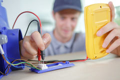 Young electrician testing flow. Young electrician testing the flow Royalty Free Stock Image
