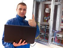Handyman working with laptop Stock Images