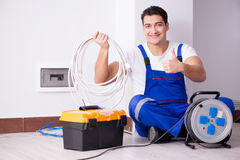 The young electrician working on socket at home. Young electrician working on socket at home Stock Images
