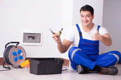 The young electrician working on socket at home Royalty Free Stock Photography