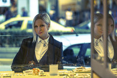 Young elegance woman near shop window with jewels. Stock Photos