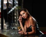 Beautiful woman sitting in bar royalty free stock photos