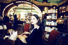 Young elegant brunette woman in cafe drinking cofe Stock Photo
