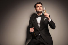 Young elegant business man enjoying a glass of champagne Royalty Free Stock Photography