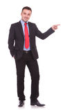 Young elegant business man pointing with one hand. Stock Photos