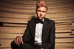 Young elegant business man posing on wood background Stock Photo