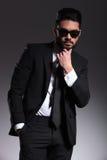 Young elegant business man thinking. Stock Photo