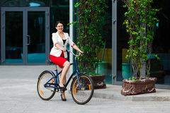 Young elegant business woman with bicycle Royalty Free Stock Photo